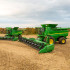 Two John Deere S-series on field